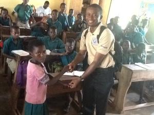 Congratulating a hard working child in a rural school@Ajumako, Ghana